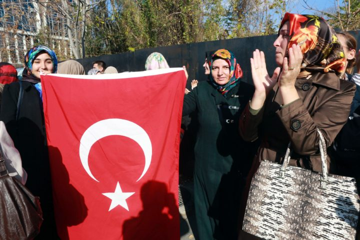 2016-11-12 11:19:37 Two women holds a Turkish flags as relatives of martyrs and veterans stage a protest against Austria regarding their attitude towards Turkey and terrorism on November12, 2016 outside the Austria Embassy in Ankara. / AFP PHOTO / ADEM ALTAN