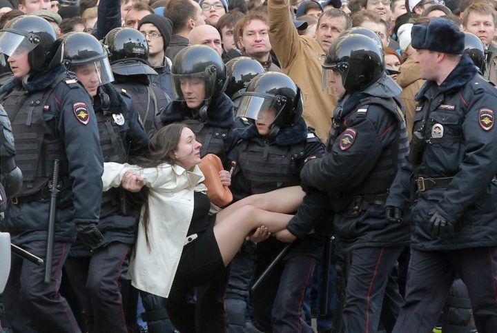 2017-03-26 19:11:01 epa05871912 Russian riot policemen detain a demonstrator during an opposition rally in central Moscow, Russia, 26 March 2017. Russian opposition leader Alexei Navalny called on his supporters to join a demonstration in central Moscow despite a ban from Moscow authorities. Throughout Russia the opposition held the so-called anti-corruption rallies. According to reports, dozens of demonstrators have been detained across the country as they called for the resignation of Russian Prime Minister Dmitry Medvedev over corruption allegations. EPA/MAXIM SHIPENKOV