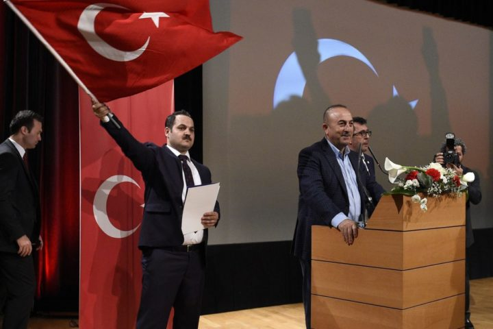 2017-03-12 14:56:01 Turkish Foreign Minister Mevlut Cavusoglu (C) arrives to give a speech on March 12, 2017 at the congress hall in the French eastern city of Metz, during a meeting to support Turkish president ahead of an April referendum that would boost his powers. The meeting, organised by a Turkish association, takes place after Dutch authorities barred Cavusoglu from entering the Netherlands, where he, too, had planned to campaign for the April referendum. The Netherlands, which holds general elections on March 15, 2017, had repeatedly said Cavusoglu was not welcome to campaign for the referendum in the country and refused his plane permission to land. / AFP PHOTO / Jean-Christophe VERHAEGEN
