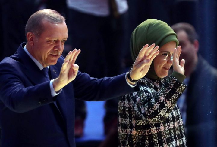 2017-03-07 13:05:30 Turkish President Recep Tayyip Erdogan (L) and his wife Emine Erdogan (R) salute the crowd during a rally with the Turkey Youth Club Federation on March 7, 2017, in Ankara, as part of his campaign for a 'Yes' vote in an April 16 constitutional referendum aimed at expanding his powers. / AFP PHOTO / ADEM ALTAN