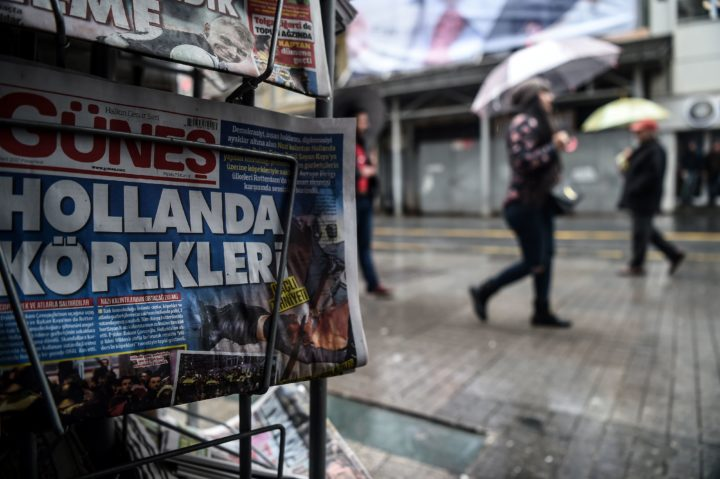 "2017-03-13 11:11:25 This picture taken in Istanbul on March 13, 2017 shows a newspaper bearing a headline concerning diplomatic tensions between Turkey and The Netherlands, which translates as """"Dogs of Europe"" in Istanbul on March 13, 2017. Turkish President Recep Tayyip Erdogan warned the Netherlands would pay for blocking his ministers from holding rallies to win support in a referendum on expanding his powers, as a crisis escalated with Turkey's key EU partners.Erdogan also repeated hugely controversial accusations that the Netherlands -- occupied by Nazi Germany in World War II -- was behaving like fascists in its treatment of Turkish ministers. / AFP PHOTO / OZAN KOSE"