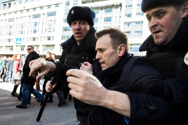 2017-03-26 17:54:57 epa05871940 A handout photo made available by Navalny's Campaign Headquarters shows Russian opposition leader Alexei Navalny (C) being detained by Russian police officers during an opposition rally in central Moscow, Russia, 26 March 2017. Russian opposition leader Alexei Navalny called on his supporters to join a demonstration in central Moscow despite a ban from Moscow authorities. Throughout Russia the opposition held the so-called anti-corruption rallies. According to reports, dozens of demonstrators have been detained across the country as they called for the resignation of Russian Prime Minister Dmitry Medvedev over corruption allegations. EPA/EVGENY FELDMAN FOR NAVALNY'S CAMPAIGN HANDOUT HANDOUT EDITORIAL USE ONLY/NO SALES