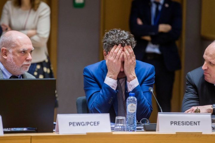 2017-03-20 16:19:28 epa05860215 President of Eurogroup, Dutch Finance Minister, Jeroen Dijsselbloem (C) covers his face prior to the start of a Eurogroup Finance Ministers' meeting at the European Council headquarters in Brussels, Belgium, 20 March 2017. EPA/STEPHANIE LECOCQ