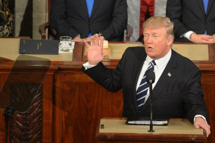 2017-02-28 21:15:01 U.S. President Donald J. Trump (C) makes remarks during his address to a joint session of Congress, as Vice President Mike Pence (L) and House Speaker Paul Ryan listen, at the U.S. Capitol, in Washington, DC, February 28, 2017. Trump, in his first address to Congress, laid out his agenda on issues like immigration, the economy, foreign affairs and health care. / AFP PHOTO / Mike Theiler