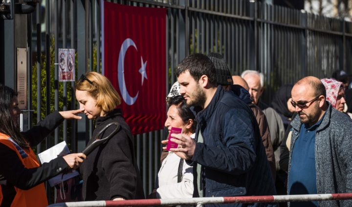 2017-03-27 11:15:45 Turkish nationals living in Germany get a security check before casting their ballot at the Turkish consulate in Berlin on March 27, 2017. The 1,4 million Turkish voters living in Germany can participate in a pro Turkish President Recep Tayyip Erdogan referendum scheduled for 16 April. / AFP PHOTO / Odd ANDERSEN