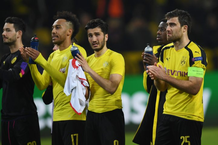 2017-04-12 21:39:53 Dortmund's players react after the UEFA Champions League 1st leg quarter-final football match BVB Borussia Dortmund v Monaco in Dortmund, western Germany on April 12, 2017. The match had been postponed after three explosions hit German football team Borussia Dortmund's bus late on April 11, 2017 ahead of a Champions League home game. / AFP PHOTO / PATRIK STOLLARZ