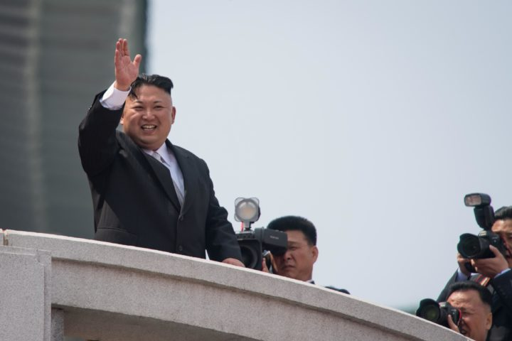 2017-04-15 14:33:14 North Korean leader Kim Jong-Un wqaves from a balcony of the Grand People's Study house following a military parade marking the 105th anniversary of the birth of late North Korean leader Kim Il-Sung, in Pyongyang on April 15, 2017. Kim saluted as ranks of goose-stepping soldiers followed by tanks and other military hardware paraded in Pyongyang for a show of strength with tensions mounting over his nuclear ambitions. / AFP PHOTO / ED JONES