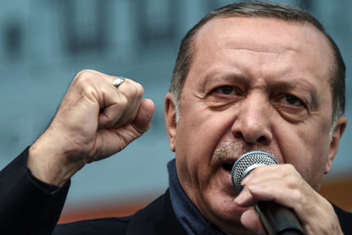 "2017-03-26 13:08:39 Turkish President Recep Tayyip Erdogan gestures as he delivers a speech during a rally on March 26, 2017 in Istanbul. Turkish President Recep Tayyip Erdogan on March 26 lashed out again in the diplomatic row with the European Union saying it would be ""easier"" if the EU just rejected Turkey's bid to join the bloc. / AFP PHOTO / OZAN KOSE"
