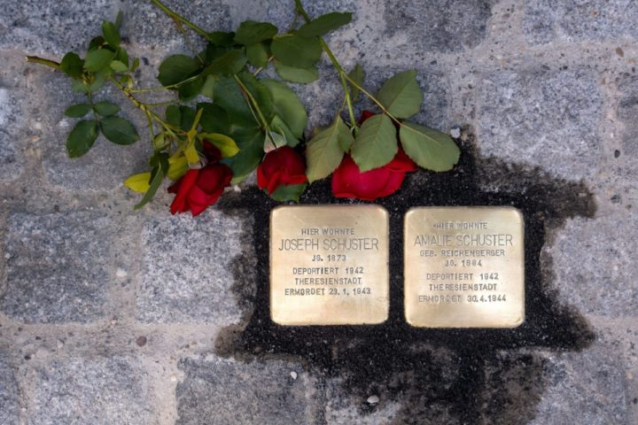 2016-07-04 00:00:00 epa05407433 Roses lie next to 'Stolpersteine' (stumbling stones) placed in memory of Amalie and Joseph Schuster, who were murdered by Nazis, on private property in the Franz-Joseph-Strasse in Munich, Germany, 04 July 2016. The brass memorial stones by German artist Gunter Demnig are permenant reminders of former Jewish residents who were persecuted by the Nazis, deported, murdered or driven to suicide. The city of Munich has officially decided against laying of stumbling blocks in public places with the justification that the names of Nazi victims should not be trampled on. EPA/SVEN HOPPE