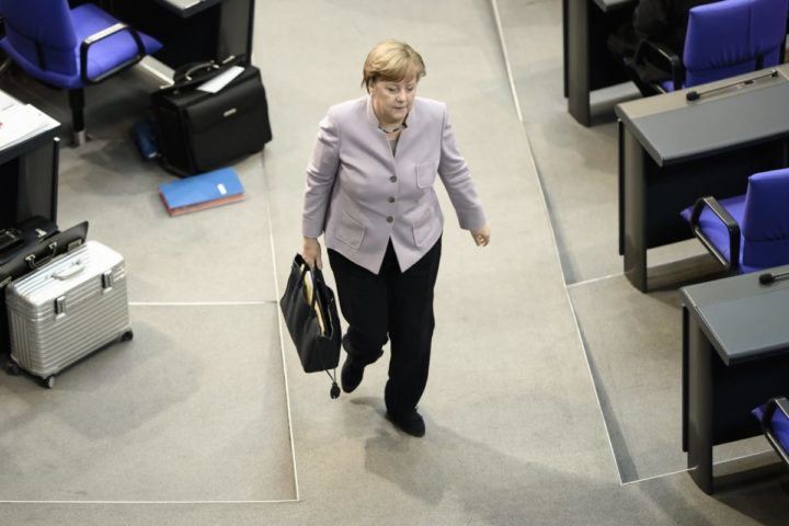2017-04-27 11:00:19 epa05930302 German Chancellor Angela Merkel leaves the plenum after a debate following her government declaration at the German Parliament 'Deutscher Bundestag' in Berlin, Germany, 27 April 2017. Merkel spoke about Germany's attitude towards the so called Brexit. EPA/CLEMENS BILAN