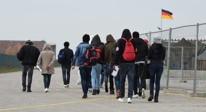 2016-11-15 11:47:23 Migrants arrive at the first registration point for asylum seekers in Erding near Munich, southern Germany, on November 15, 2016. The refugees from Eritrea came by plane from Italy. / AFP PHOTO / CHRISTOF STACHE