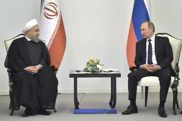 2016-08-08 12:54:41 epa05464429 Russian President Vladimir Putin (R) and Iranian leader Hassan Rouhani attend a meeting in Baku, Azerbaijan, 08 August 2016. The talks between Russian President Vladimir Putin, his Azerbaijani counterpart Ilham Aliyev and Iranian leader Hassan Rohani are mainly focused on the North-South Transport Corridor ship, rail, and road route for moving freight between India, Russia, Iran, Europe and Central Asia, as well as well as anti-terrorism cooperation. EPA/ALEXANDER NEMENOV/POOL