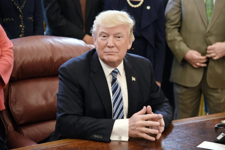 2017-04-27 14:21:28 epa05931590 US President Donald J. Trump looks on after signing a Memorandum on Aluminum Imports and Threats to National Security in the Oval Office of the White House in Washington, DC, USA 27 April 2017. EPA/Olivier Douliery / POOL