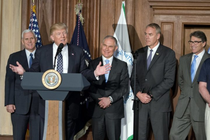 2017-03-28 14:19:15 epa05875927 United States President Donald J. Trump makes remarks prior to signing an Energy Independence Executive Order at the Environmental Protection Agency (EPA) Headquarters in Washington, DC, USA, on 28 March 2017. The order reverses the Obama-era climate change policies. From left to right: US Vice President Mike Pence; the President; EPA Administrator Scott Pruitt; US Secretary of the Interior Ryan Zinke; and US Secretary of Energy Rick Perry. EPA/Ron Sachs / POOL