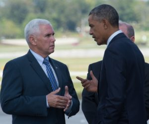2014-10-03 14:15:44 US President Barack Obama(R) and Indiana Governor Mike Pence chat at Evansville Regional Airport in Indiana upon Obama's arrival on October 3, 2014. Obama will visit the Millennium Steel Service and have a conversation with workers as part of Manufacturing Day to discuss investments in American manufacturing. AFP PHOTO/Nicholas KAMM