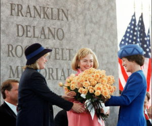 1997-05-02 14:03:00 Princess Margriet (R), of the Netherlands, accepts a bouquet of flowers from US First Lady Hillary Clinton (C) and Tipper Gore (L) during dedication ceremonies for a monument to her godfather at the Franklin Delano Roosevelt Memorial in Washington, DC, 02 May. The memorial, covering seven-and-a-half acres near the Tidal Basin, depicts 12 years of American history through a series of rooms, each devoted to one of Roosevelt's four terms as the 32nd US president. AFP PHOTO/ Paul J. RICHARDS