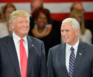 2016-07-25 00:00:00 ROANOKE, VA - JULY 25: Republican presidential candidate Donald Trump (L) and Republican vice presidential candidate Mike Pence listen to cheers from the audience at the The Hotel Roanoke & Conference Center on July 25, 2016 in Roanoke, Virginia. Trump made a point to address the evangelicals during his visit to the bible belt. Trump is campaigning with a bump in the polls following the Republican National Convention where he accepted the party's nomination. Sara D. Davis/Getty Images/AFP == FOR NEWSPAPERS, INTERNET, TELCOS & TELEVISION USE ONLY ==