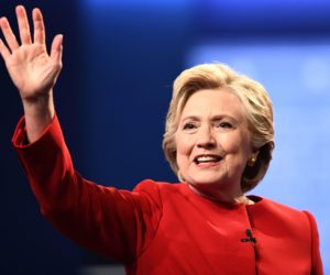 2016-09-26 21:42:08 TOPSHOT - Democratic nominee Hillary Clinton waves after the first presidential debate at Hofstra University in Hempstead, New York on September 26, 2016. / AFP PHOTO / Jewel SAMAD