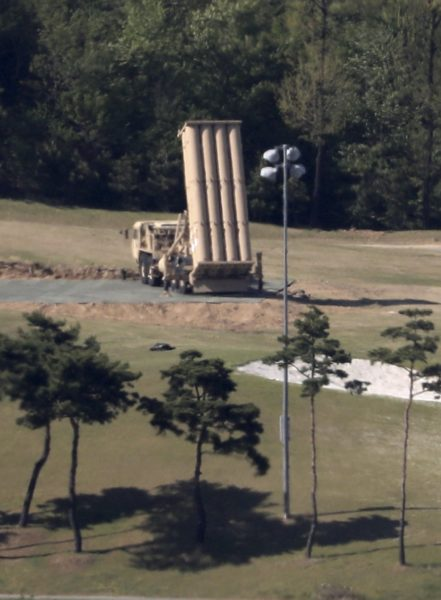 2017-05-01 16:53:12 epa05938239 A Terminal High Altitude Area Defense (THAAD) launcher sits at a golf course in Seongju, about 300 kilometers southeast of Seoul, South Korea, 01 May 2017. On the same day, South Korea ruled out renegotiation of the cost for the deployment of the US missile defense system, responding to pressure from the Donald Trump administration to share the financial burden. EPA/YONHAP SOUTH KOREA OUT - BEST QUALITY AVAILABLE
