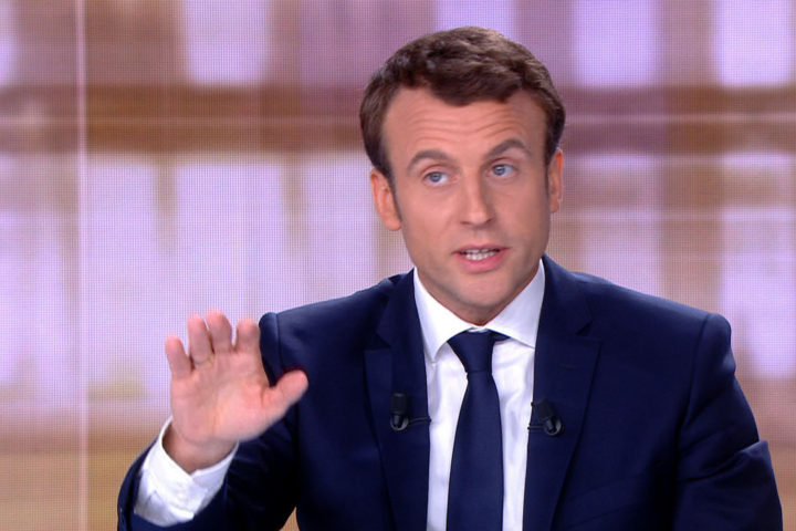 2017-05-03 16:09:24 A video grab from an AFP video taken on May 3, 2017 during a live brodcast televised debate in television studios of French public national television channel France 2, and French private channel TF1 in La Plaine-Saint-Denis, north of Paris, shows French presidential election candidate for the En Marche ! movement Emmanuel Macron talking during a face to face debate with French presidential election candidate for the far-right Front National (FN) party, ahead of the second round of the French presidential election. Pro-EU centrist Emmanuel Macron and far-right leader Marine Le Pen face off in a final televised debate on May 3 that will showcase their starkly different visions of France's future ahead of this weekend's presidential election run-off. / AFP PHOTO / STRINGER