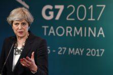 May opent aanval op Corbyn vanuit G7-top