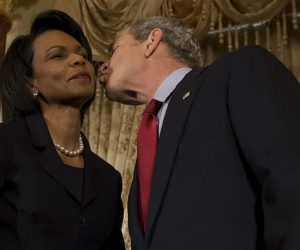2009-01-15 20:26:00 US President George W. Bush (R) kisses US Secretary of State Condoleezza Rice (L) during a ceremony at the US State Department in Washington, DC, January 15, 2009 commemorating foreign policy achievements during the Bush administration. AFP PHOTO/Jim WATSON