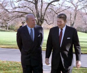 12/4/1986 President Reagan walking with George Shultz outside of the Oval Office