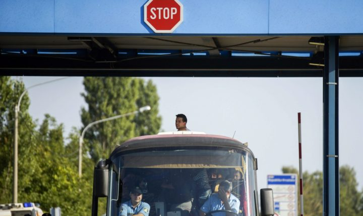 2015-09-23 14:39:04 epa04945638 A migrant looks out of the roof of a Croatian bus at the border crossing between Hungary and Croatia at Beremend, 237 kms south of Budapest, Hungary, 23 September 2015. Hungary will close its borders with Croatia if Greek border are not better protected, Hungarian Prime Minister Viktor Orban told journalists ahead of a Brussels summit on the migration crisis in Europe. EPA/ZOLTAN BALOGH HUNGARY OUT