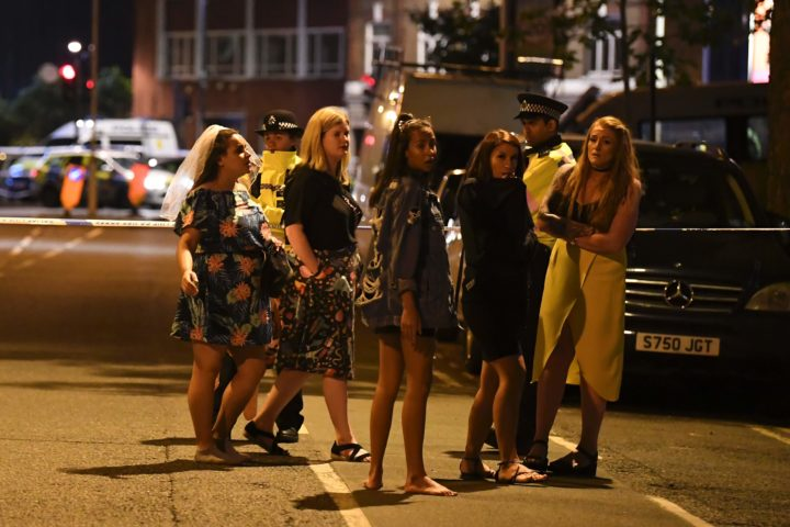 "2017-06-04 02:35:34 Women stand at a police cordon set up in London on June 4, 2017 following a terrorist attack on London Bridge and Borough Market. Armed police opened fire during what they described as a ""terrorist"" attack in central London Saturday after reports of stabbings and a van ploughing into pedestrians just days ahead of a general election. / AFP PHOTO / Justin TALLIS"