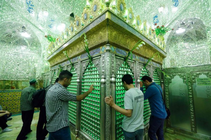 2016-06-07 13:27:40 Iranian men pray at the tomb of Emamzadeh Saleh at a mosque in Tajrish square in northern Tehran on June 7, 2016, during the holy fasting month of Ramadan. Across the Muslim world, the faithful fast from dawn to dusk, and abstain from eating, drinking, smoking and having sex during that time as they strive to be more pious and charitable. / AFP PHOTO / ATTA KENARE